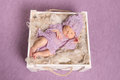 Sweet Newborn Sleeping In Square Cot On Violet Background Stock Photography - 83639752