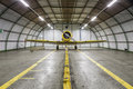 Vintage Old Yellow War Plane Inside Of A Empty Hangar Royalty Free Stock Photography - 83655097