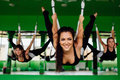Young Women Making Antigravity Yoga Exercises With A Group Of People. Aero Fly Fitness Trainer Workout. White Hammocks. Stock Photography - 83675582