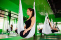 Young Women Making Antigravity Yoga Exercises With A Group Of People. Aero Fly Fitness Trainer Workout. White Hammocks. Stock Photography - 83675812