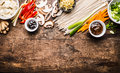 Asian Vegetarian Cooking Ingredients For Stir Fry With Tofu, Noodles, Ginger, Cut Vegetables, Sprout,green Onion , Lemongrass, Hoi Stock Photo - 83702350
