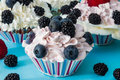 CUPCAKES WITH CREAM AND BERRIES. Royalty Free Stock Photo - 83724835