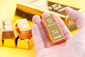 Hand Hold Gold Bars Stock Photography - 83733382