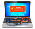 Laptop With Virus Attack Warning Message On Screen And Stethoscope Royalty Free Stock Image - 83751056
