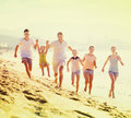 Big Family Running On Beach Stock Images - 83813604