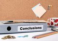 Conclusions. Folder, Coffee Mug, Colored Pencils On Wooden Office Deskn Royalty Free Stock Image - 83833916