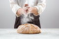 The Male Hands In Flour And Rustic Organic Loaf Of Bread Royalty Free Stock Images - 83871479
