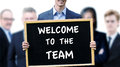 Businessman Holding Sign With Words Welcome To The Team Stock Images - 83928444