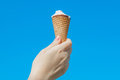 A Woman Hand Holding  Icecream On Blue Sky Royalty Free Stock Image - 83952176