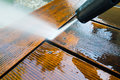Cleaning Terrace With A Power Washer Royalty Free Stock Images - 83954129