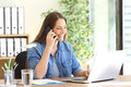 Entrepreneur Calling On Phone Working With Laptop Stock Photography - 83967282