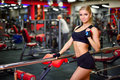 Pretty Fitness Girl Holding A Jump Rope In The Gym, Looking Right, The Background Beautifully Blurred Stock Image - 83990361