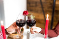 Young Happy Couple Celebrating Valentine`s Day With A Dinner At Home Toasting With Wine Royalty Free Stock Photography - 84024457