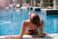 Summer Vacation Carefree Woman Relaxing In Swimming Pool. Royalty Free Stock Photo - 84025695