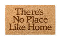 There Is No Place Like Home Welcome Mat On White Stock Photography - 84025702
