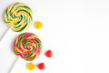 Sweets And Sugar Candies On White Background Top View Royalty Free Stock Photography - 84027557