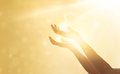 Woman Hand Praying For Blessing From God On Sunset Stock Photo - 84036510