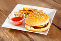 Fresh Cheeseburger And Potato Fries With Ketchup On White Plate Royalty Free Stock Photography - 84045837