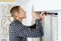 Installing Wooden Blinds. Royalty Free Stock Photo - 84081615
