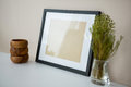 Picture Frame With Wooden Pencil Holder And Vase Stock Images - 84095024