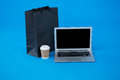 Shopping Bag And Disposable Coffee Cup With Laptop Royalty Free Stock Photos - 84096878
