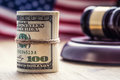 Judge`s Hammer Gavel. Justice Dollars Banknotes And Usa Flag In The Background. Court Gavel And Rolled Banknotes. Stock Photo - 84131320