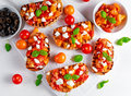 Tasty Traditional Tomato Bruschetta With Feta Cheese Topping, Fresh Basil. Royalty Free Stock Image - 84171446
