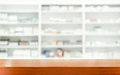 Brown Wooden Tabletop With Blurred Pharmacy Stock Image - 84175631