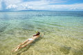 Young Woman Snorkeling In Clear Water On Taveuni Island, Fiji Royalty Free Stock Photos - 84179068