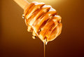 Honey Dripping From Honey Dipper Isolated On Yellow Royalty Free Stock Images - 84195549