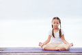 Child Doing Exercise On Platform Outdoors. Healthy Lifestyle. Yoga Girl Royalty Free Stock Photo - 84199205