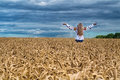 Girl Rise Up Among The Wheat Field Royalty Free Stock Photo - 84202885