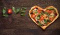 Valentines Day Pizza In Heart Shape With Inscription Love On Dark Rustic Wooden Background. Stock Photo - 84211440
