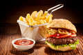 Burger With French Fries And Ketchup Royalty Free Stock Photography - 84217257