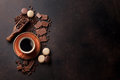 Coffee Cup, Chocolate And Macaroons On Old Kitchen Table Stock Images - 84229914