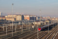 Train On Railways With Typical Buildings And Muontains On Background. Lingotto District. Turin. Italy. Stock Photos - 84260403