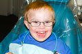 Boy With Downs-Syndrome Sitting In Dentist Chair Royalty Free Stock Photography - 84261257