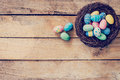 Colorful Easter Egg In The Nest On Wood Background With Space Royalty Free Stock Photo - 84271075