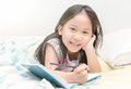 Cute Asian Girl Smile And Writing To Diary On The Bed Royalty Free Stock Photos - 84271758