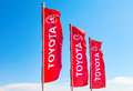 Official Dealership Flags Of Toyota Against The Blue Sky Stock Image - 84281251