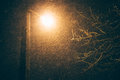 Street Lamp At Night During A Snowfall, A Bottom View Royalty Free Stock Image - 84306396