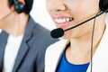 Smiling Woman Wearing Microphone Headset As An Operator Or Tele Stock Image - 84331311