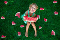 Little Blonde Girl Sitting On The Grass Around A Slices Of Watermelon In Summer. Happy. Stock Photos - 84335213