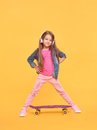 Pretty Little Girl Standing On Yellow Background Royalty Free Stock Images - 84338229
