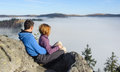 Couple Looking Around. Fog Covered The Hills Royalty Free Stock Images - 84345639