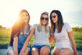 Three Beautiful Female Friends Against Sunny Landscape Royalty Free Stock Photo - 84348705