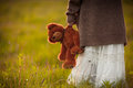 Girl Holding In Hand Brown Teddy Bear On Morning Field Royalty Free Stock Photos - 84357448