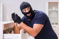 The Robber Wearing Balaclava Stealing Valuable Things Royalty Free Stock Images - 84363689