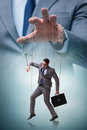 The Businessman Puppet Being Manipulated By Boss Stock Photos - 84364003