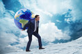 The Businessman Carrying Earth On His Shoulders Stock Photo - 84367990